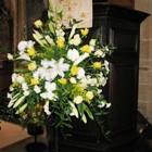 White and gold floral arrangement by the pulpit in Ashover Church