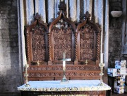 carved reredos of North altar in Ashover Church
